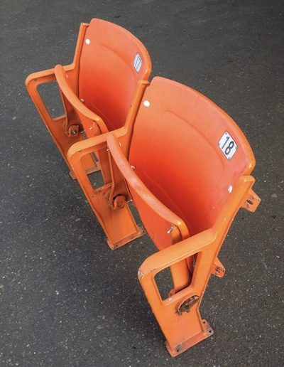 Orange floor mounted seats from RFK stadium