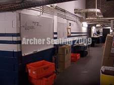 The corridor past the locker rooms.
