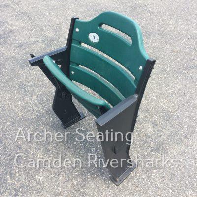 Floor mounted green stadium seat